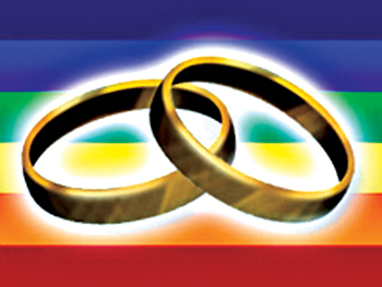 wedding bands over rainbow flag
