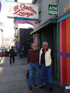 Paul Lee (left) and and Louie Lopez stand outside Aunt Charlie's Lounge, one of the last gay bars in the Tenderloin. Photo Seth Hemmelgarn.