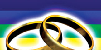 wedding bands over rainbow flag