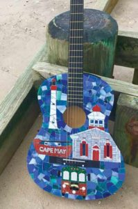 Cape May Mosaics artist Lori Erdley and one of her guitar creations
