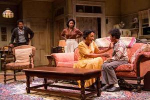 "Brandon J. Dirden (Walter Lee Younger), Crystal A. Dickinson (Ruth Younger), Brenda Pressley (Lena Younger) and Owen Tabaka (Travis Younger) in ""A Raisin in the Sun"" at Two River Theater."