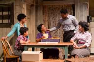 "Jasmine Batchelor (Beneatha Younger), Owen Tabaka (Travis Younger), Brenda Pressley (Lena Younger), Brandon J. Dirden (Walter Lee Younger) and Crystal A. Dickinson (Ruth Younger) in ""A Raisin in the Sun"" at Two River Theater"
