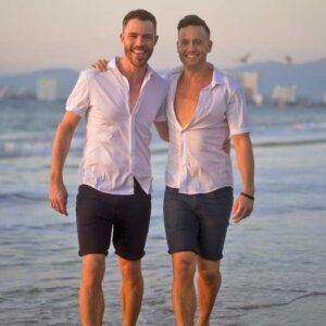 Branden James and James Clark walking on the beach