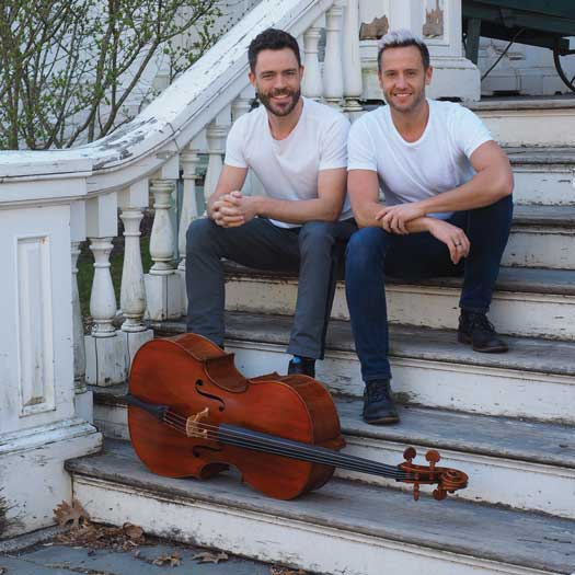 Branden James and James Clark sitting on steps
