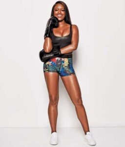 Actor Javicia Leslie dressed in shorts with with boxing gloves