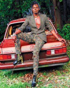 Derek Doll sitting on a car