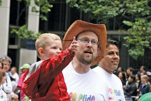 Gay dads with their son at a San Francisco Pride parade