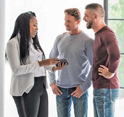Gay male couple speaking with woman
