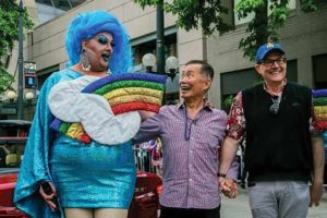 "George Takei in middle with Mama Tits and Brad Takei at Pride 2014 in Seattle. Photo courtesy ""Seattle Gay Scene."""
