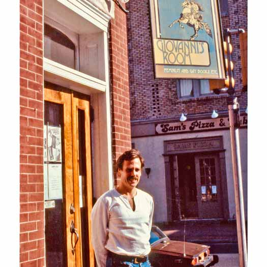 Ed Hermance standing in front of Giovanni's Room in 1980