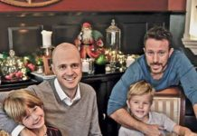 Doctors Dave and Dan with their two children at home for Christmas