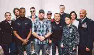 Imagine Dragons with veterans and service member