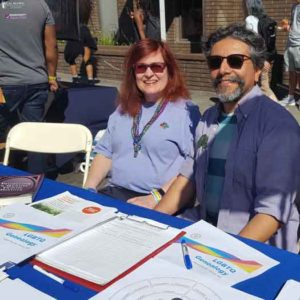 Victoria Kolakowski, left, and Stewart Blandón Traiman staffed the California Genealogical Society's table at Oakland Pride in 2018