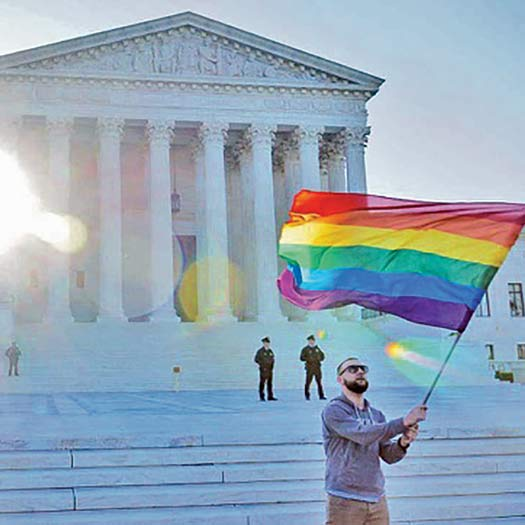 Rainbow flag waves in Washington D.C. at the U.S. Supreme Court