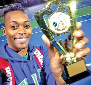 Lendale Johnson with one of his awards