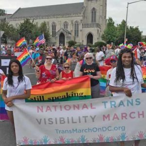 March for Trans Equality banner and marchers