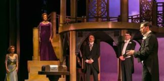"""""""The Merchant of Venice"""" at The Shakespeare Theatre of NJ. In the foreground: John Keabler as Bassanio. Pictured in background from left to right: Rachel Towne as Nerissa, Melissa Miller as Portia, Joe Penczak as Tubal, Ian Gould as Gratiano. Photo by Jerry Dalia."""
