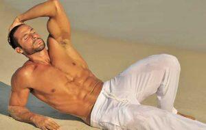 Fitness model Anthony Catanzaro on the beach