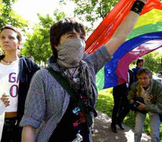 A small group of activists march a 20 meter Rainbow Flag 600 meters down the streets of Moscow, Russia