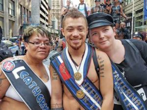Mr. International Leather 2019 Jack Thompson is in the middle