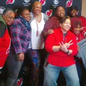 LGBT NJ Devils fans enjoy LGBT Pride Night at the ROCK. Photo by Jai Quinlan
