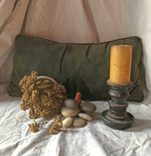 Photo of pillow and candle by Leon Calafiore
