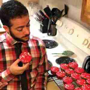 Jake Meola with some freshly baked red cupcakes