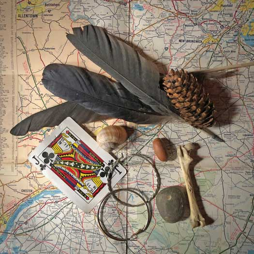 Out of the Broomcloset photo of cards and trinkets on a New Jersey map
