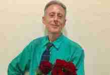 Peter Tatchell gets roses fromthe folks at the Russian LGBT Network organization