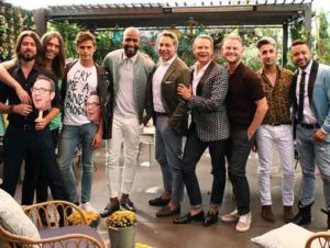 """Queer Eye"" new cast with the original cast at a reunion"