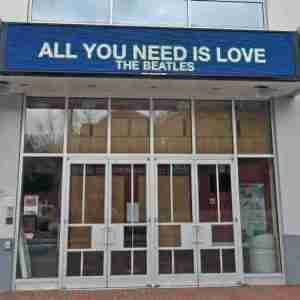 "Beatles' iconic hit song ""All You Need Is Love"" on SOPAC marquee"