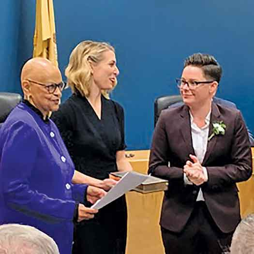 The Lambertville, NJ swearing in of Mayor Julia Fahl (on the right, with wife Kari Osmond, center, and Congresswoman Bonnie Watson-Coleman on left). Jan. 1, 2019 photo by Eric Rounds.