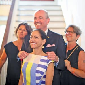 Tammy and Phil Murphy with supporters at LGBT reception at the NJ Governor's residence in 2018.