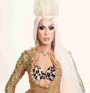 Alaska Thunderfuck wearing a gold dress and red contacts