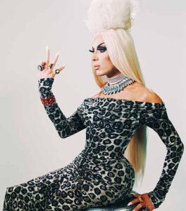 Alaska Thunderfuck wearing a leopard print dress