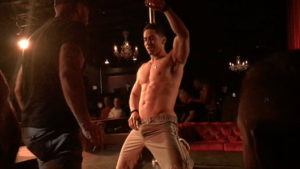 All Male, All Nude: Johnsons' male stripper leaning on pole.