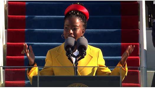 Amanda Gorman at President Joe Biden's inauguration wearing a yellow jacket