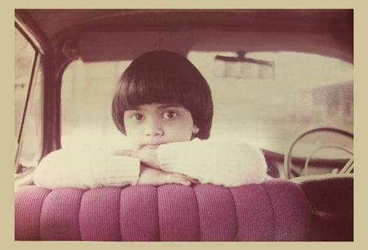 Girl looking over the seat inside a car