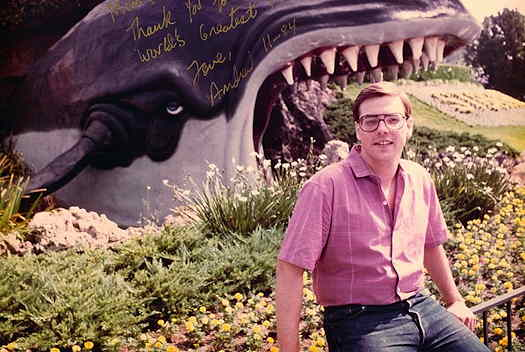 Andrew Exler its in front of a whale at Disneyland