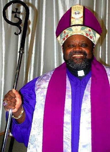 Archbishop Carl Bean wearing white, lavender and purple bishop robe