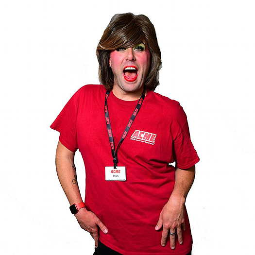 Aunt Mary Pat wearing a red ACME t-shirt