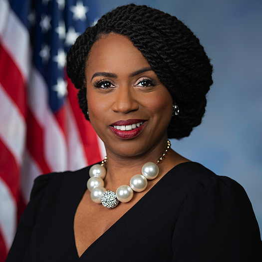 Ayanna Pressley USA flag in background