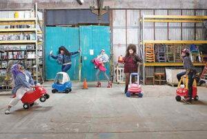 Drag queens in a garage