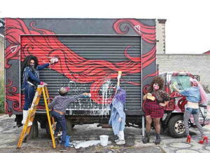 Drag queens washing a truck