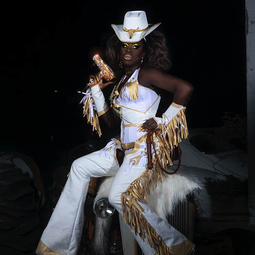 Bob the Drag Queen wearing a white cowboy outfit