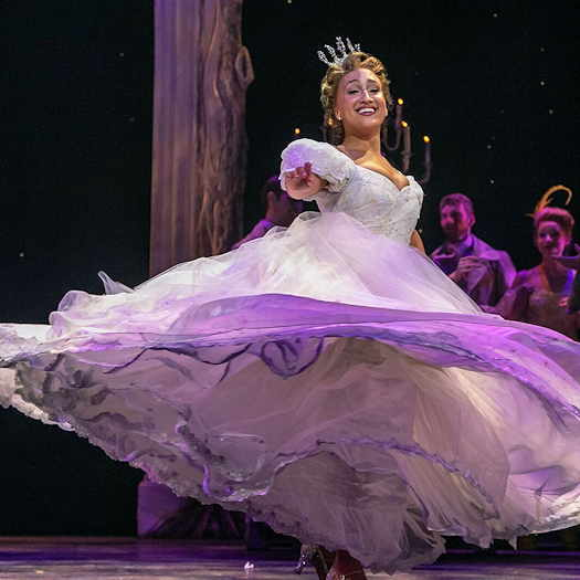 Rodgers + Hammerstein's Cinderella twirling in white gown