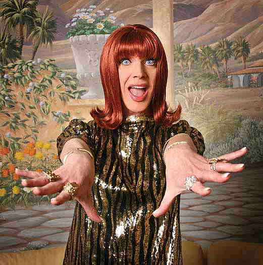 Coco Peru holding her hands towards the camera