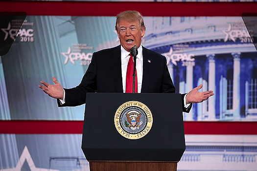Donald Trump behind podeum