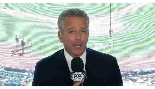 Thom Brennaman holding Fox Sports microphone