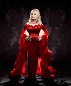 Dolly Parton wearing a long red dress